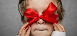 Child with holiday ribbon