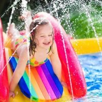 Girl playing in water at summer speech therapy camp